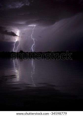 Lighting Reflecting in Water - stock photo