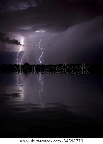 Lighting Reflecting in Water - stock photo