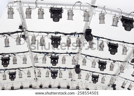 lighting rig under a white big tent  - stock photo