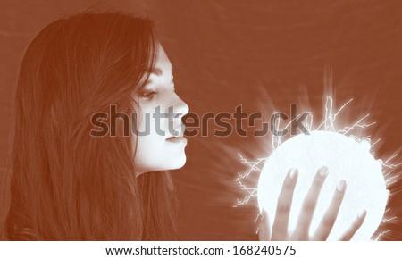 lighting sphere in hands. attractive fairy girl - stock photo