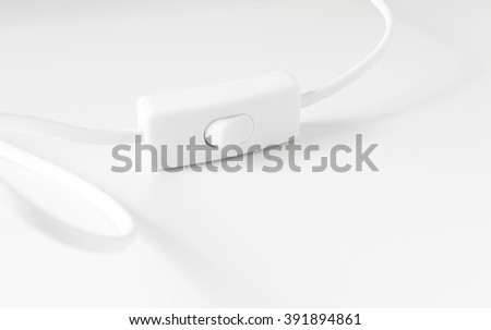 lighting switch under the white background , selective focus