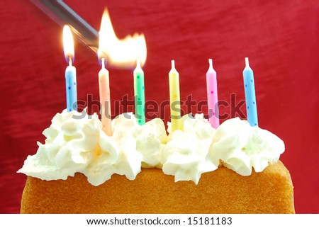Lighting the candles on a birthday cake