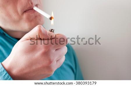 Lighting the cigarette - stock photo
