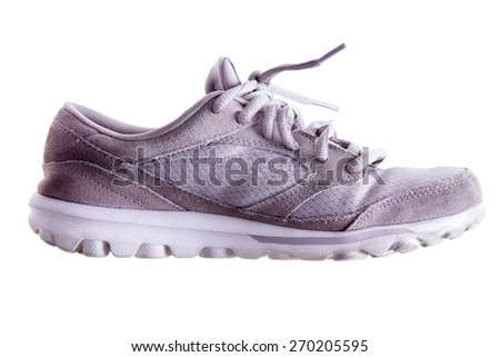Lightly used grey sports shoe or trainer with laces in a close up side view isolated on white - stock photo