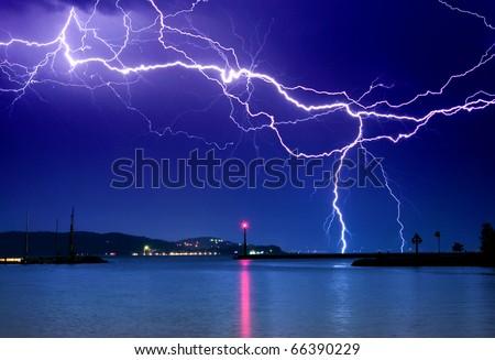 Lightning above the lake - stock photo
