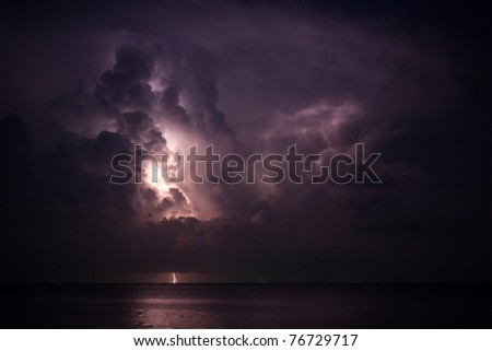 lightning above the sea - stock photo