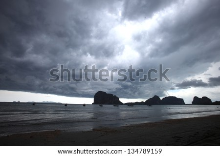 Lightning above the sea in tome of storm. Thailand - stock photo