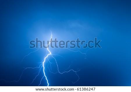 lightning against blue sky - stock photo
