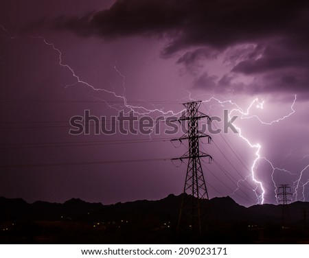 Lightning and power lines - stock photo