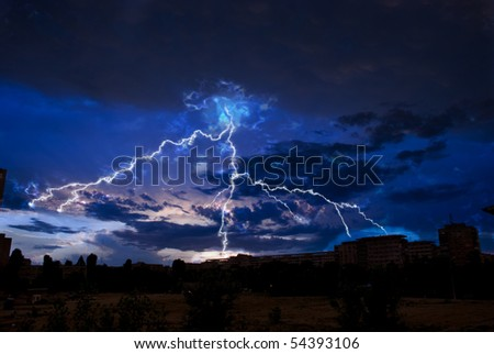 Lightning and storm clouds over the city evening - stock photo