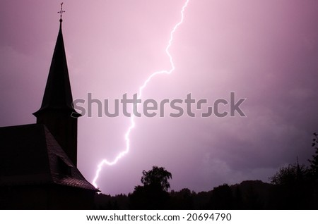 Lightning and the Church - stock photo