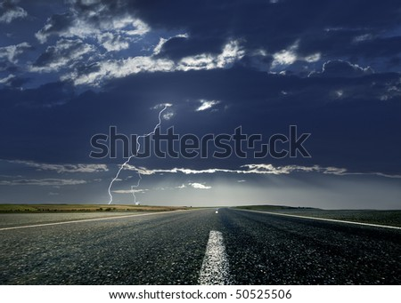 Lightning and the road ahead - stock photo