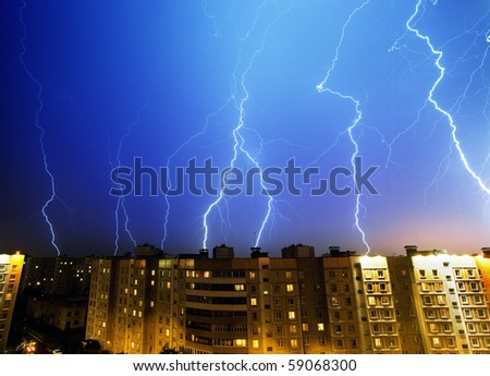 Lightning and thunderstorm above night city - stock photo