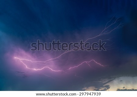 Lightning arcs across a stormy Midwestern sky in Indiana. - stock photo