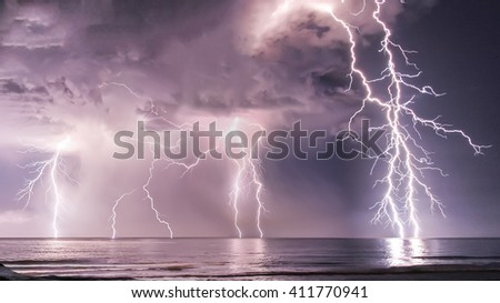 Lightning at sea - stock photo