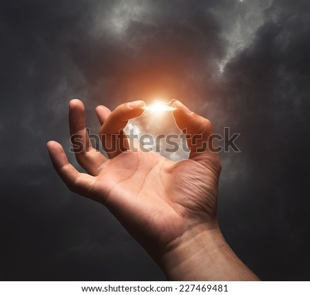 Lightning between two fingers - stock photo