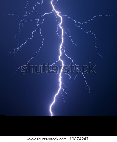 Lightning bolt at night. - stock photo