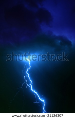 Lightning bolt in clouds - stock photo