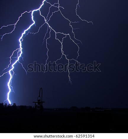 Lightning Bolt Strike at Night in the Country - stock photo
