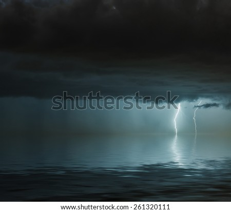 lightning bolts reflection over the ocean