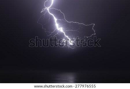 lightning bolts reflection over the sea. taken during a thunderstorm over the ocean with clouds in the background - stock photo