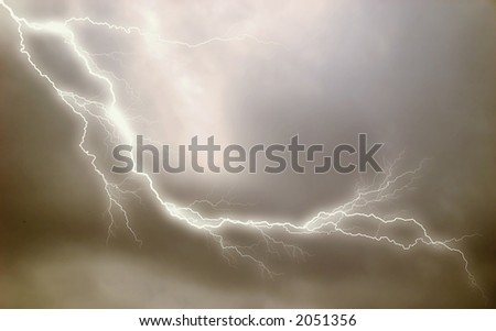 Lightning effect applied to stormy sky background. - stock photo