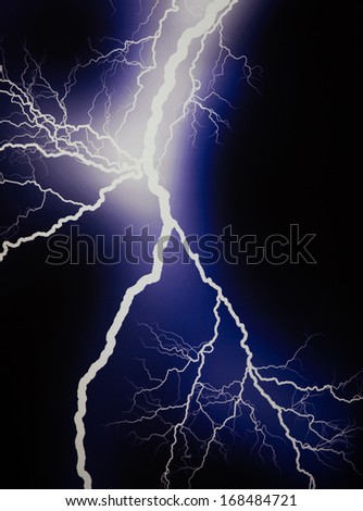 Lightning extends horizontally across a black background - stock photo
