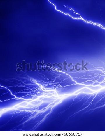 Lightning flash on a soft blue background - stock photo