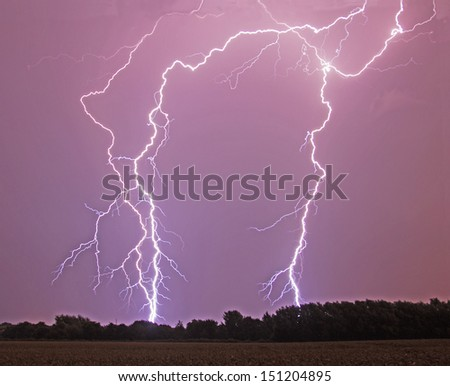 Lightning flash over a corn field - stock photo