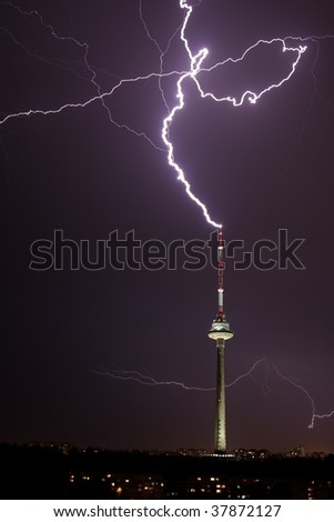 Lightning hits lonely Tv tower - stock photo
