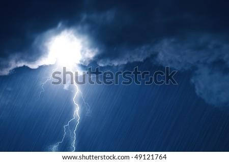 lightning in dark cloudy sky - stock photo