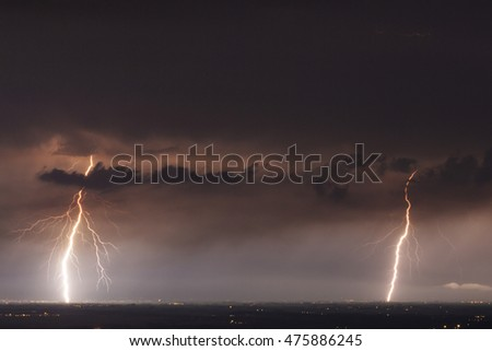 lightning in the clouds on the horizon