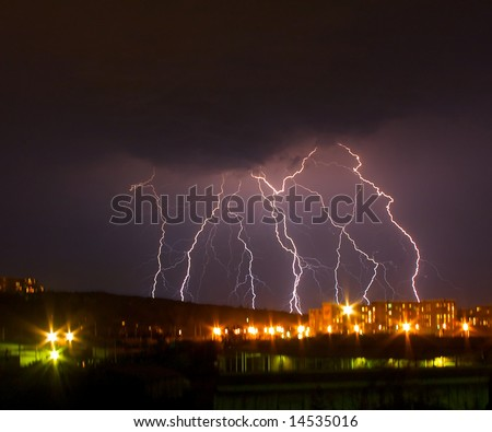 Lightning in the night sky above city