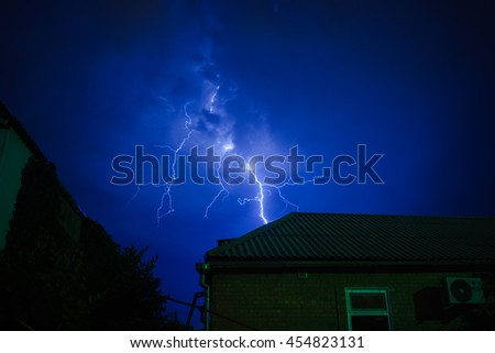 Lightning in the night sky during a thunderstorm over the holiday village