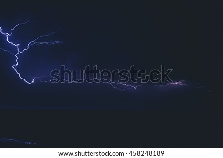 Lightning in the night sky. Effect of electric lighting, the abstract background of a techno for your project.