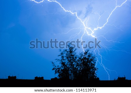 Lightning in the sky in the city - stock photo