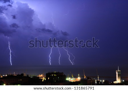 Lightning into the sea near the port of Genova, Italy during a violent storm