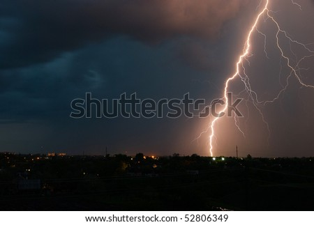Lightning over a small city - stock photo