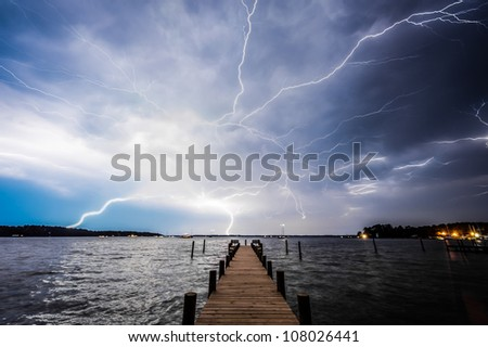 Lightning Over Pier in Deltaville, Virginia - stock photo