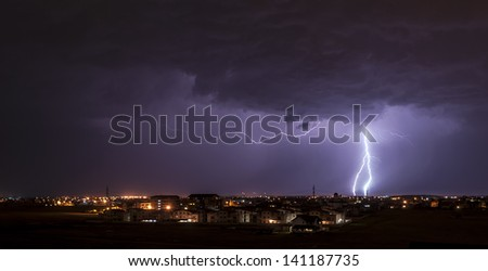Lightning over small town - stock photo