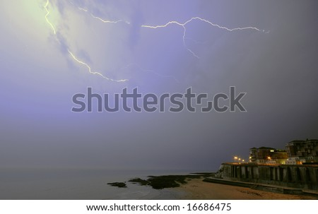 Lightning over the sea at Broadstairs UK - stock photo