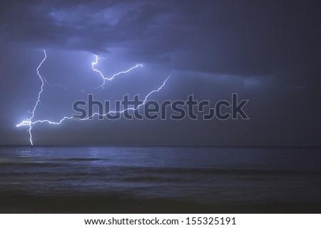 Lightning over the Sea in La Manga del Mar Menor, Cartagena, Spain - stock photo