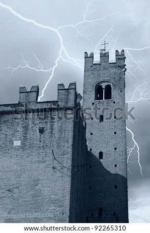 lightning over the tower of the castle - stock photo