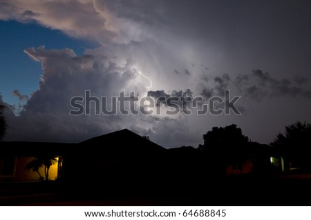 Lightning show in a local neighborhood just after sunset - stock photo