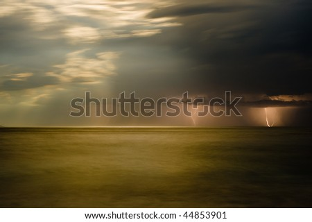 Lightning storm over Bluestone Bay on Tasmania's East Coast - stock photo
