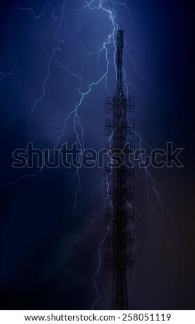 lightning storm over radio mast - stock photo