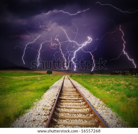 Lightning storm over railroad - stock photo