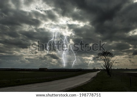 Lightning storm over road - stock photo