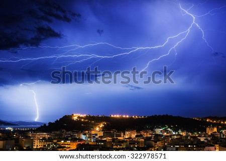 lightning storm over the city - stock photo