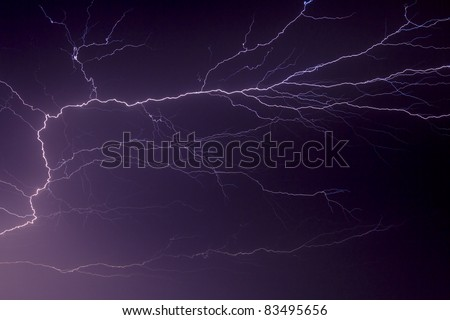 Lightning streaks and branches across the night sky in dramatic fashion over Indiana in the Midwest of the United States of America. - stock photo